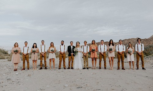 The desert provides a breathtaking backdrop for wedding party photos.
