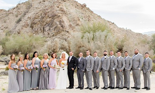 Desert mountains provide wonderful backdrops for wedding party photos.