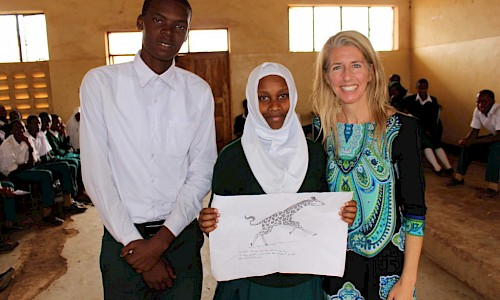 Tanzanian students present a program on giraffe ecology and conservation.