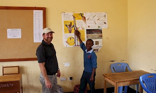 Photo of Mike Chedester with Tanzanian student.